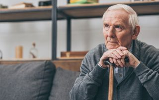 elderly man sitting at home on his couch