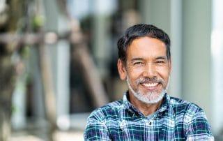 mature Asian man shows off his big smile